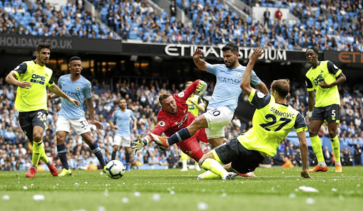 Coming to a local screen: Manchester City's Sergio Aguero, No10, scores against Huddersfield on Sunday. South African fans will soon be able to watch English Premier League matches live on SABC. Picture: REUTERS