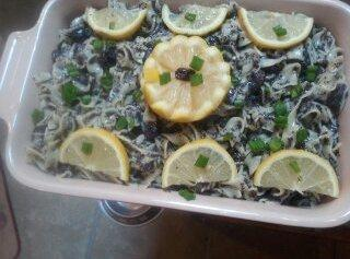Garnish top with lemon slices & chopped chive or scalloped lemon cup with raisin....