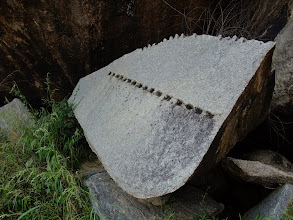 Photo: Rock in process of being split. (Probably abandoned several hundred years ago.)