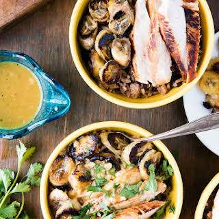 Cuban Garlic Chicken Bowls with Beans & Rice, Fried Plantains & Mojo Sauce.