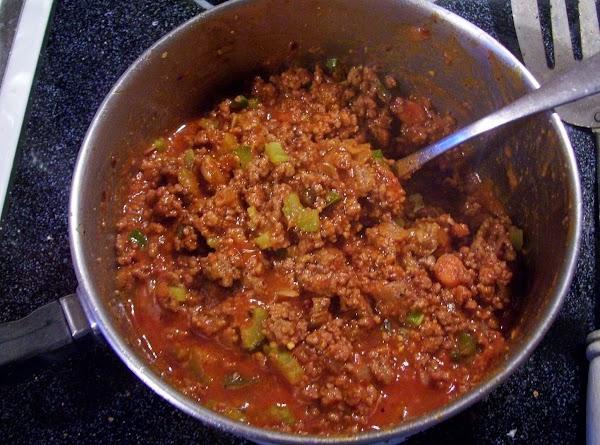 Add; garlic , green pepper, Celery & seasonings. Cook & stir over Med Heat...