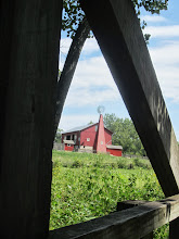 Photo: Red barn viewed from a bridge at Carriage Hill Metropark in Dayton, Ohio.