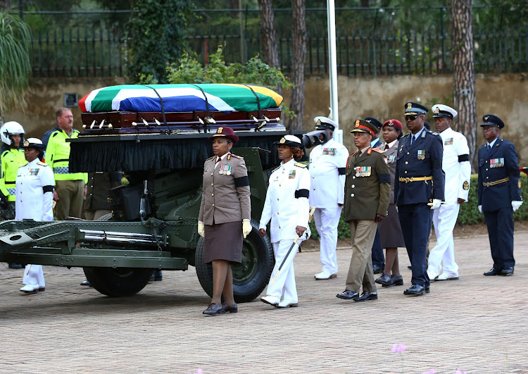 Winnie Madikizela-Mandela's coffin is given a military escort into Fourways Memorial Park where she was buried on April 14 2018.