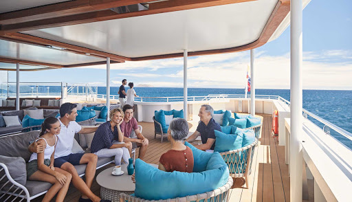 Unwind in the Sunset Lounge aboard Celebrity Flora during your visit to the Galapagos.