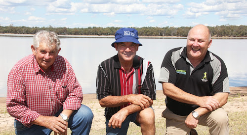 PUSH FOR WATER BORE: Long-time Yarrie Lake Flora and Fauna Reserve Trust member Bernie Smith is flanked by Collins Park Lighting Committee members Ian Duffey and Lester Kelly at Yarrie Lake yesterday to launch the bid for a bore at the lake. While the lake has water in it at present, there's not enough to let boats on it.
