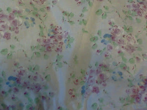 Photo: Flower detail at top of diaper stacker
