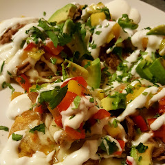 plantain chips topped w/choice of meat or vegan option... drizzled with sour cream, avocado and mango pico de gallo