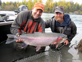 Photo: Jerry Elmer with his big Kenai rainbow . This trout believe it or not was sight fished on a gravel bar just upstream of a slow drop off. This pig put up an epic battle.