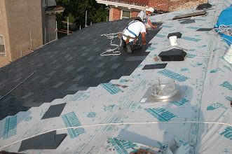 Photo: July 2005 - Month 23: New roofing surface - back of the house