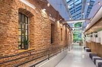The inside of a long hallway inside a modern business building.