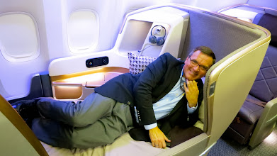 Photo: Yours truly testing out the big wide bed in business class on Singapore Air's new B777-300ER. Cushy!
