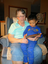 Photo: Hello Grandma. We're going to have fun together, but first, let's read a story.