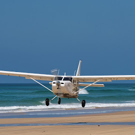 Beach Take Off by Garry Dosa - Transportation Airplanes ( plane, sand, outdoors, blue, ocean, beach, lift-off, action, movement, water, propellor,  )