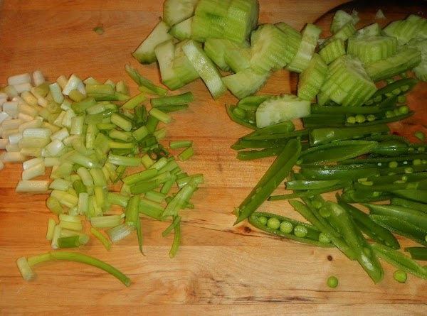 Cucumbers skinned, and scored down with a fork,  for pretty appearance. Grandma always said scoring...