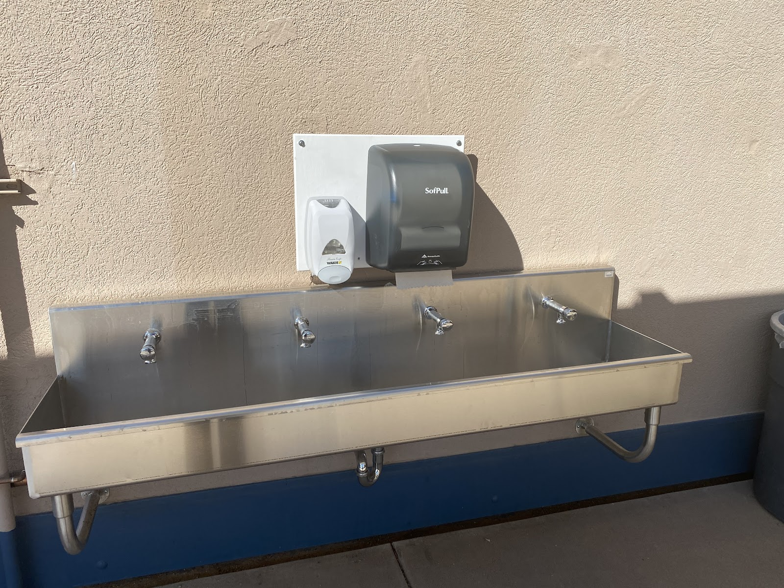 A handwashing station with four faucets was installed right outside of the cafeteria for student use