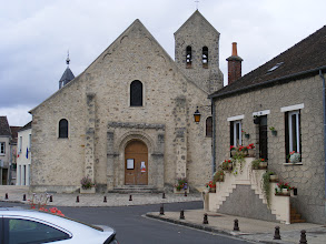 Photo: The 11th century Église de St. Mammès has the heavy appearance of Romanesque churches from the era. The steeple peeking up on the left side actually belongs to the town hall behind the church.
