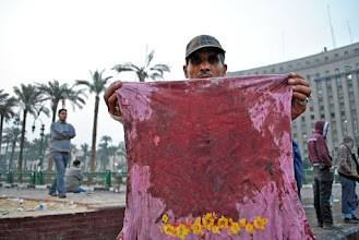 Photo: A blood-stained shirt belonging to one of the protesters stands as a grisly reminder of the attack that took just took place.