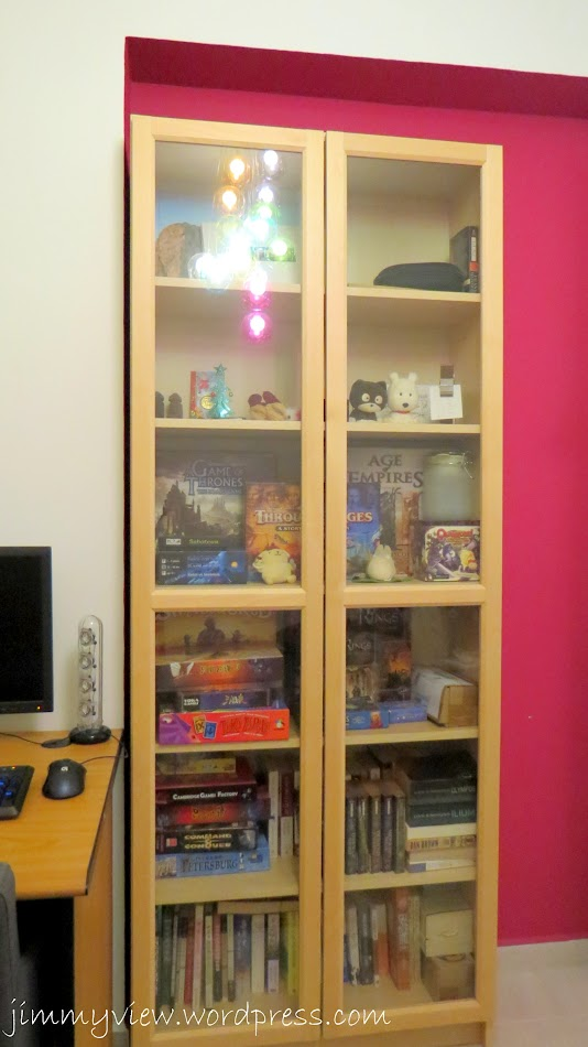 Cabinet with boardgames and books.