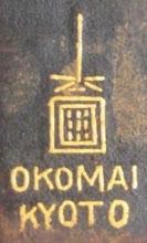 Photo: Late mark of O. Komai shop