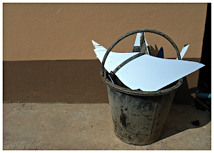 Photo: Bad Luck  Actually it was good luck for me as I happened to be walking by as someone dumped the bucket with the broken mirror in it just outside the guesthouse. The concrete floor & two tone brown painted wall make the perfect background. The shadows were leading the eye to the right hand side of the shot which was perfect as that was where the darkest area was anyway. The mirror itself (although broken) had been discarded in the bucket in such a way as to catch the crystal blue sky which added the one & only bright colour in the shot!