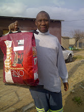 Photo: The owner of a strerilised dog receiving some donated dogfood