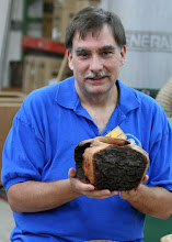 Photo: Tim Aley shows the hollow vessel from a hollow log.