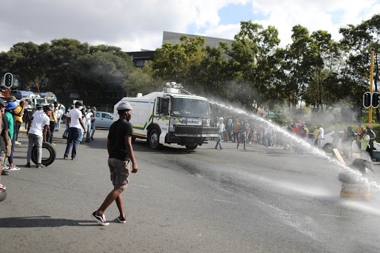 The police used water cannons to disperse protesting Wits University students on Monday.