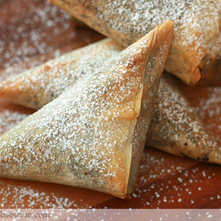 Chocolate Phyllo Triangles with Cream Cheese and Nut Stuffed Dry Fruits.
