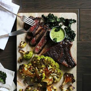 Aged Rib-Eye Steak with Roasted Cauliflower, Kale Chips, and Sweet Pea Aioli.