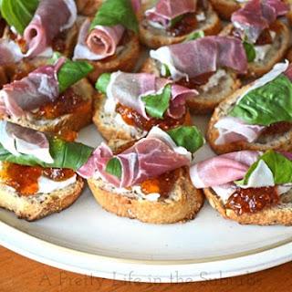 Prosciutto, Basil, Fig Jam & Goat Cheese Crostinis.
