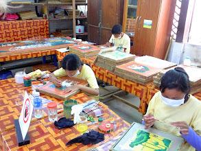 Photo: Artisans painting on silk