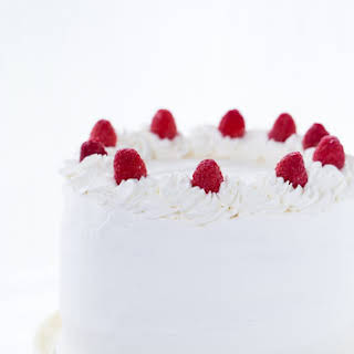 Coconut Raspberry Cake with Whipped Cream Frosting.
