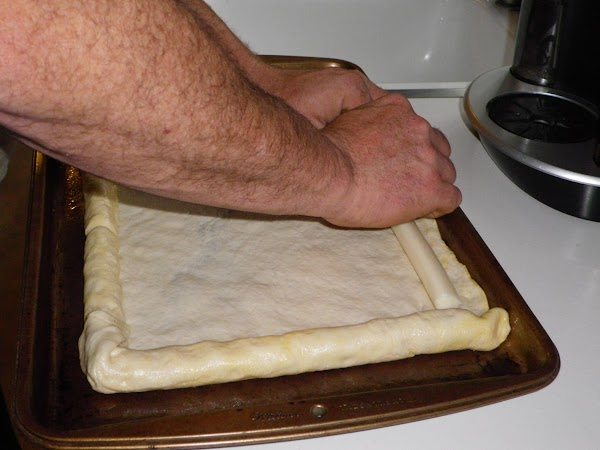 Heat oven to 425 degrees.  Grease or spray a 13x9-inch pan. Unroll dough...