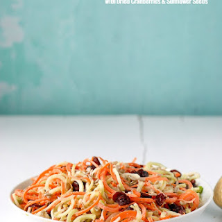 Spiralized Broccoli-Stem Carrot Slaw with Dried Cranberries & Sunflower Seeds