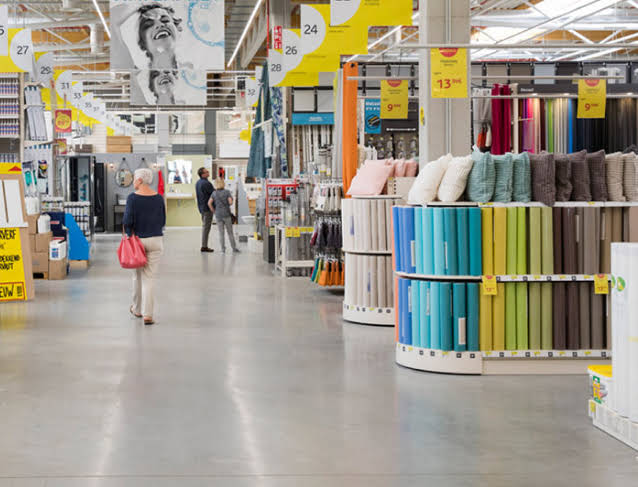 Woman shopping at fabric store