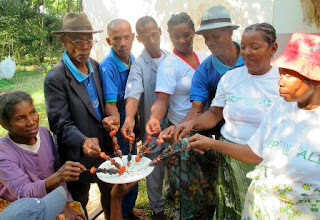 Photo: Submitted by CPALI  Farmers share beetle kabobs as part of CPALI's insect farming program in Madagascar.