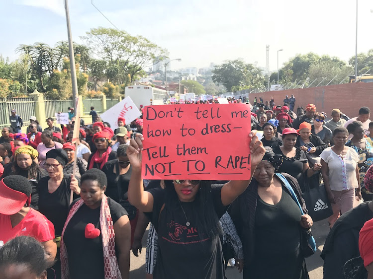 FILE IMAGE: About 800 marchers armed with placards calling for the dismantling of patriarchy and the protection of women make their way through the streets of Durban to the city hall.