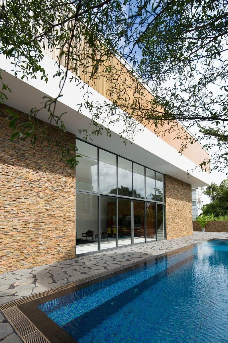 Trip to Thao Dien Vietnam and Take Ultra-Modern Fuschia Villa: inspiring pool with brick deck plus brick house also glass wall design