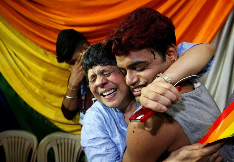 People belonging to the lesbian, gay, bisexual and transgender community celebrate after the Supreme Court decriminalised gay sex at an NGO in Mumbai, India on September 6 2018. Picture: REUTERS/FRANCIS MASCARENHAS