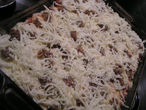 Next, add another layer of sauce on top of the noodles.  Add ½...
