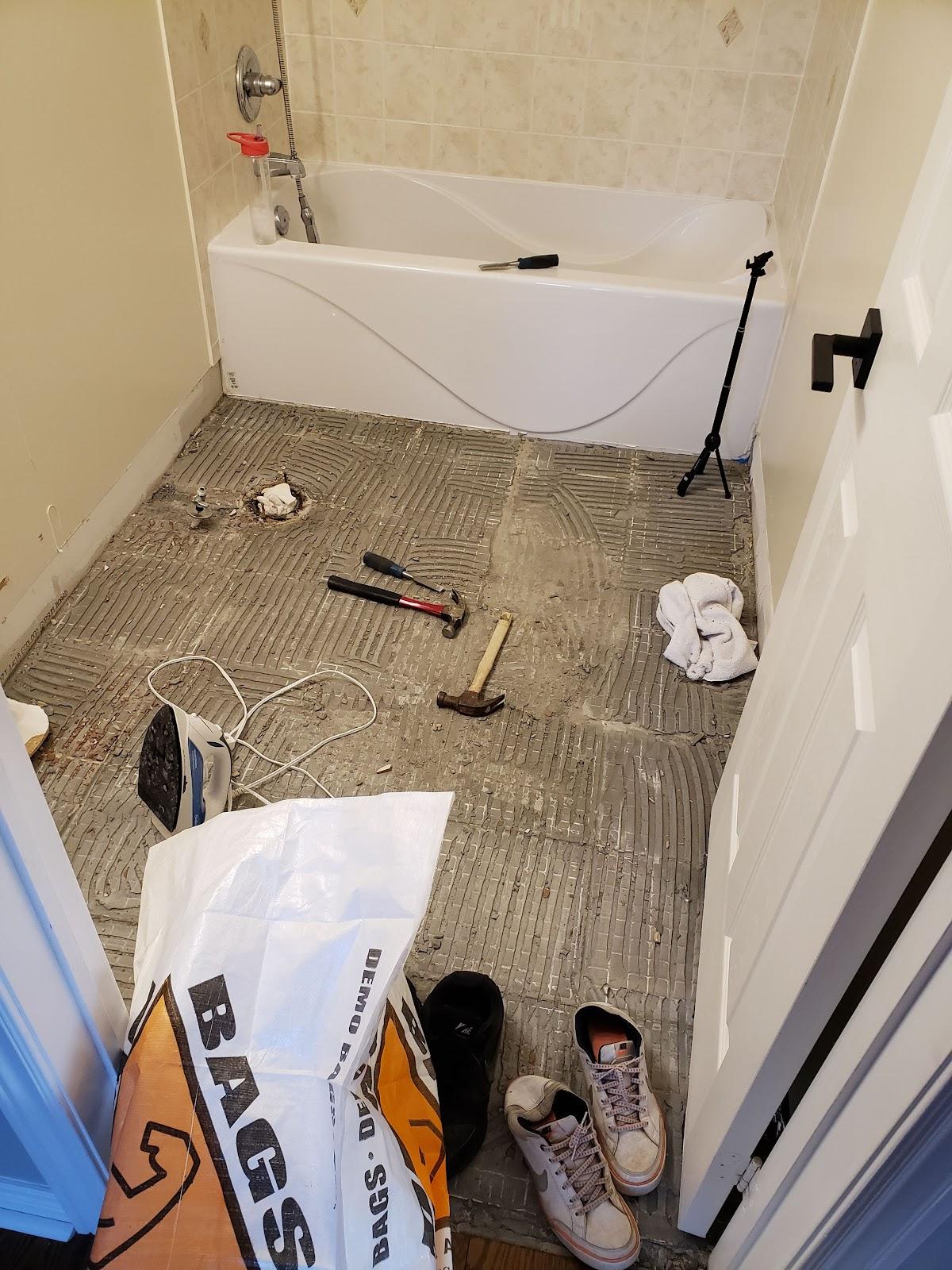 Remove bathroom floor tiles for a bathroom renovation