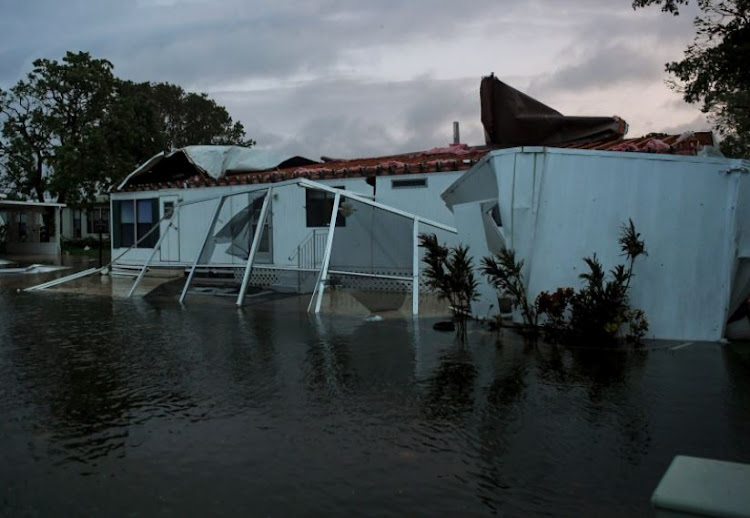 Flood water from Hurricane Irma surround a damaged mobile home in Bonita Springs, Florida, US, September 10, 2017.