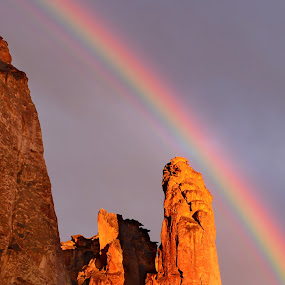 Rainbow in Leslie Gulch by Mary Lane Anderson - Landscapes Weather ( leslie gulch, sunset, weather, eastern oregon, rainbow, rocks )