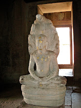 Photo: statue of Buddha sitting on naga, Phimai