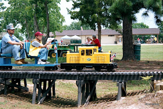 Photo: Jim and Mauri Cash on the train with Andy and Doug Blodgett at table.   SWLS - HALS 2001-0526