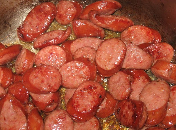 Heat large pot. Add olive oil then brown sausage. Remove from pot with a...