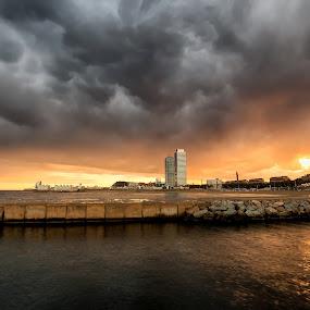 Angry sky of Barcelona by Torsten Funke - Landscapes Sunsets & Sunrises ( cityscapes, water, skyline, angry, beach, cityscape, storm, sky, sunset, skylines, storms, barcelona, rain )