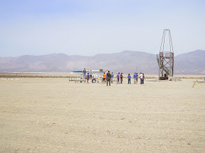 Photo: The UCSD team loading their liquid fueled rocket onto the launch rail.