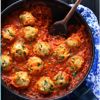Chickpea Dumplings in Curry Tomato Sauce.