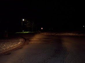 Photo: Low beams, 150 feet. Firefighter with no reflective gear cannot be seen next to stop sign. This is the stopping distance for a vehicle on dry pavement at a speed of approximately 45 MPH